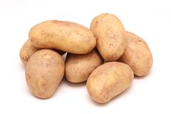 Raw potatoes pile stock images