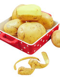 Raw potatoes in red tray Royalty Free Stock Images