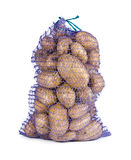 Raw potatoes in a sack Stock Image