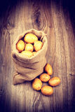 Raw potatoes in the sack Stock Photography