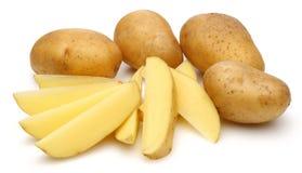 Raw potatoes and sliced potatoes stock image