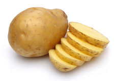 Raw potatoes and sliced potatoes stock photography