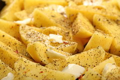 Raw potatoes with spices ready to be roasted stock images
