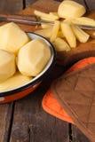 Raw potatoes in a vintage enamel bowl Stock Photos