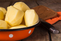 Raw potatoes in a vintage enamel bowl Royalty Free Stock Photography