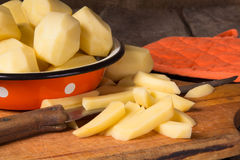 Raw potatoes in a vintage enamel bowl Stock Photo