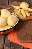 Raw potatoes in a vintage enamel bowl Stock Photography