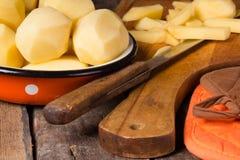 Raw potatoes in a vintage enamel bowl Royalty Free Stock Image