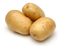 Raw potatoes. On white background stock image