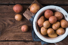 Raw potatoes in a white bowl on a napkin copy spase Stock Photography