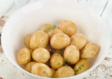 Raw potatoes on a white wooden board. Stock Photography