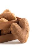 Raw potatoes in wooden box Royalty Free Stock Images