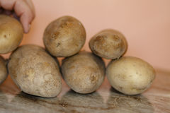 Raw potatoes. On wooden table Stock Photo