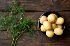 Raw potatoes on wooden table. Top view Stock Images