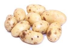 Raw potatos three. Raw potatos for eating on white background Royalty Free Stock Photo