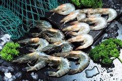 Raw prawn. Several fresh raw prawn display on chopping board Stock Photo