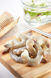 Raw Prawn. On chopping board with clean lighting Stock Photos