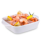 Raw prawn. On ice with lemon, lime and fresh rosemary Stock Photo