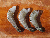 Raw prawns. On wooden plate Stock Image