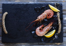 Raw prawns with lemon and ice, selective focus Royalty Free Stock Photography