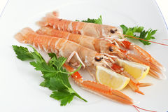 Raw prawns with lemon and parsley Royalty Free Stock Image
