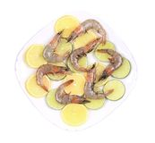 Raw prawns on lemon slices. Stock Photography