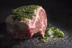 Raw Prime Ribeye Roast with Parsley and Salt Rub Stock Image