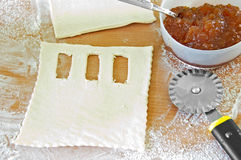 Raw puff pastry with jam. Royalty Free Stock Images