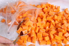 Raw pumpkin cubes in a spoon. In bags Stock Photography