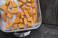Raw pumpkin in roasting dish Stock Photography