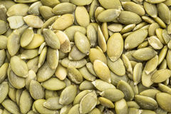 Raw pumpkin seeds background Royalty Free Stock Photography