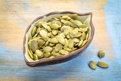 Raw pumpkin seeds in a leaf bowl Stock Photography