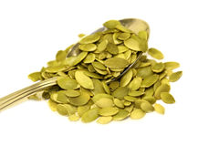 Raw Pumpkin Seeds On Spoon Stock Photo