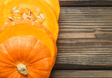 Raw pumpkin slices on the dark table Stock Photography