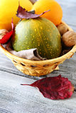 Raw pumpkin in a wicker basket Royalty Free Stock Images