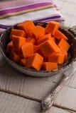 Raw pumpkin on wooden background. Fresh raw pumpkin in bowl on wooden background. Selective focus Stock Image