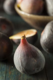 Raw Purple Organic Figs. On a Background Stock Photo