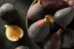 Raw Purple Organic Figs. On a Background Royalty Free Stock Image