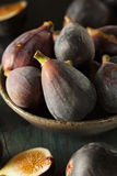 Raw Purple Organic Figs. On a Background Royalty Free Stock Images