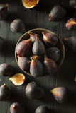 Raw Purple Organic Figs. On a Background Royalty Free Stock Photos