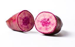 Raw purple potato isolated on white Stock Photography