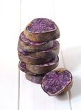 Raw purple potato Stock Photo