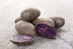 Raw purple potatoes. Royalty Free Stock Photos