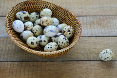 Raw quail eggs in a basket. Food Stock Image