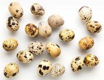 Raw quail eggs closeup. On a white background Stock Image