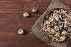 Raw quail eggs. Group of raw quail eggs on wooden background Stock Image