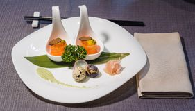 Raw quail eggs with truffle and horseradish, served with wasabi royalty free stock images