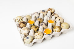Raw quail eggs on the white background Stock Photography