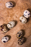 Raw quail eggs on the wooden background Royalty Free Stock Photos