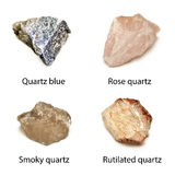Raw quartz. 4 quartz stones  on white background:quartz blue, rose quartz, smoky quartz, rutilated quartz Royalty Free Stock Image